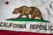 Photo Full frame close-up on a waving flag of California (USA) in 3D rendering.