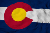 Photo Full frame close-up on a waving flag of Colorado (USA) in 3D rendering.