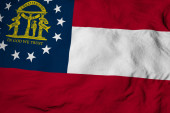 Photo Full frame close-up on a waving flag of Georgia (USA) in 3D rendering.