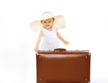 Little Lady child in a straw hat and with suitcase, travel, vaca