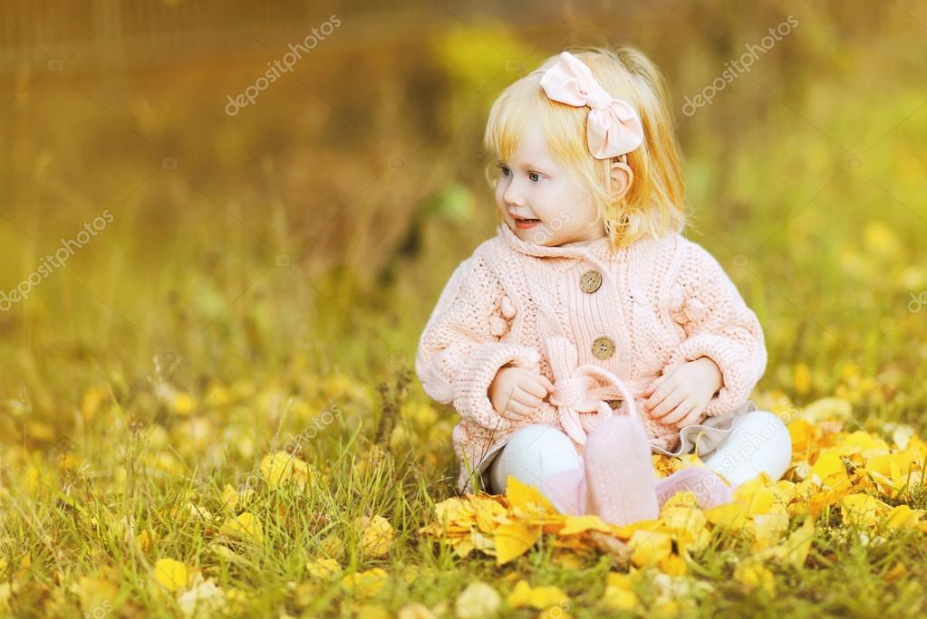 Little cute girl in autumn day