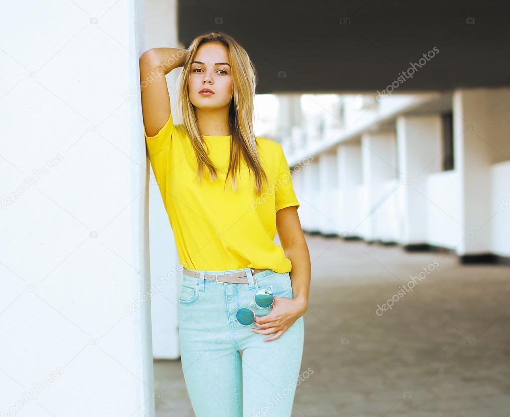 Pretty sexy woman model posing in the city, street fashion