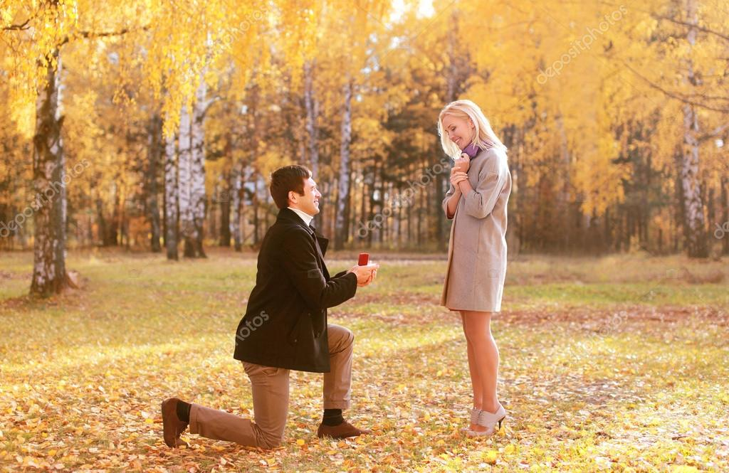Love, couple, relationship and engagement concept - kneeled man