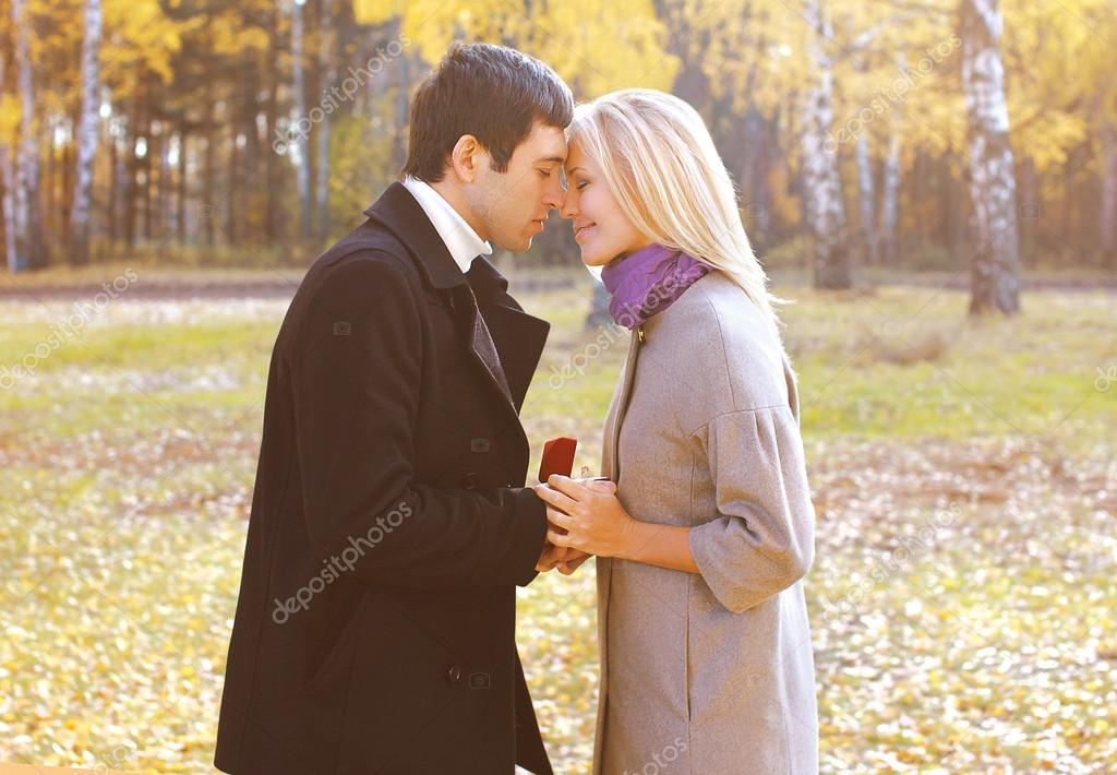 Love, couple, relationship and engagement concept - man proposin