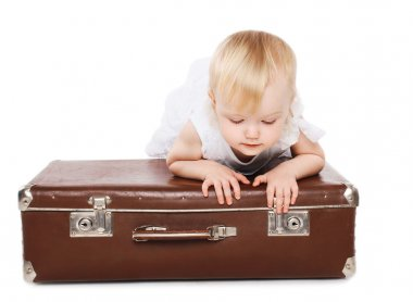 Little child and a suitcase, family travel - concept
