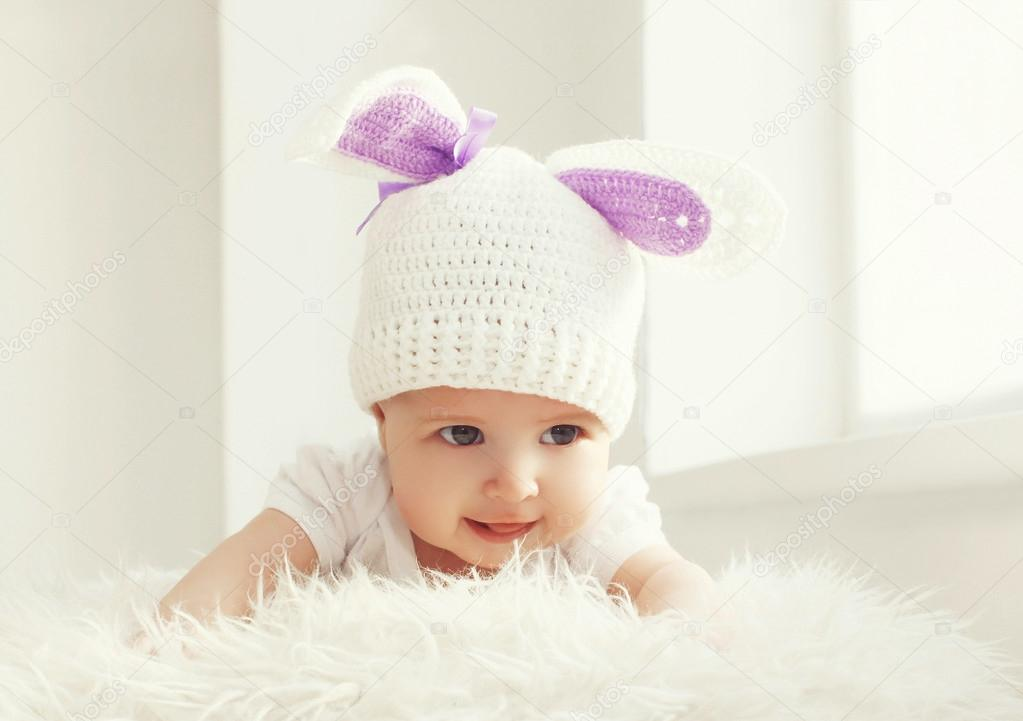 Portrait of cute baby in white knitted hat with ears rabbit at h — Stock  Photo 1a137253a15