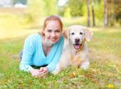 Portrait happy smiling owner woman and Golden Retriever dog lyin