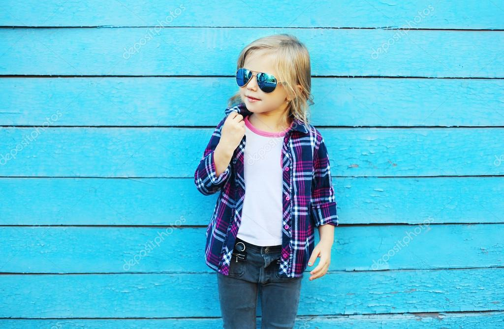 Fashion kid in city, stylish child wearing a sunglasses and checkered shirt  over blue background, profile view — Фото автора Rohappy 533038276b9