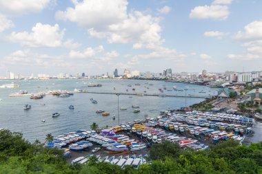 Boat and bridge at the harbor in Pattaya bay