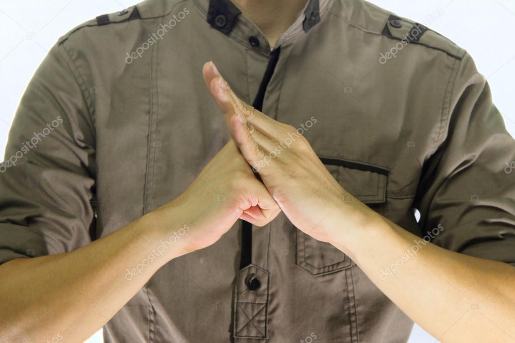 Chinese salute greetings sing stock photo rukawajung 77453676 a chinese martial arts greeting features the right hand in a fist with the left hand open covering it with a slight nod of the head photo by rukawajung m4hsunfo