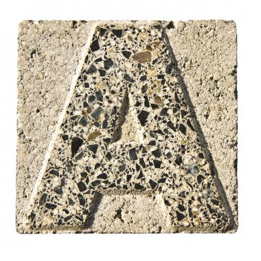 Letter A carved in a concrete block