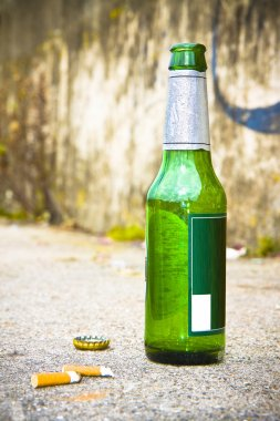 Bottle of beer resting on the ground