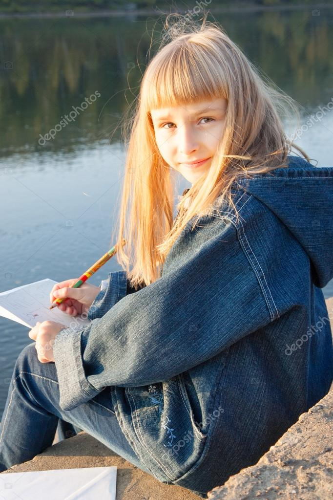 Young girl  sitting on a park.