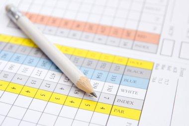 Pencil on a golf scorecard
