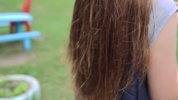 Beautiful brunette tossing her hair