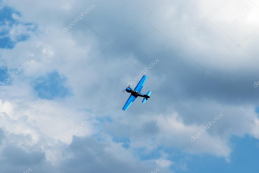 Aerobatics in the blue sky with clouds