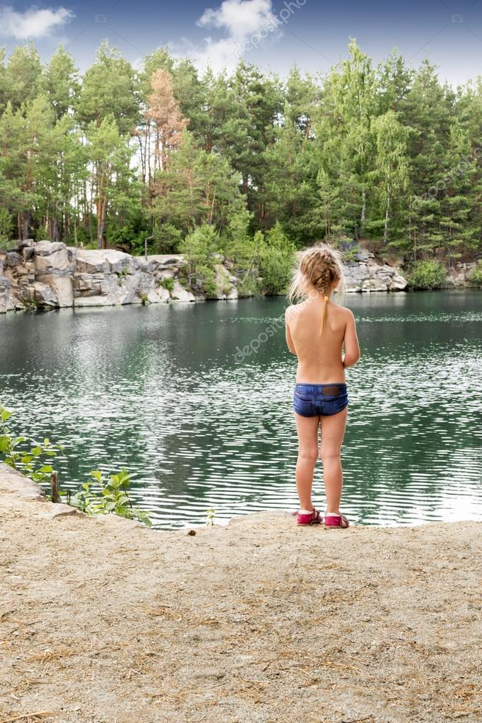 Little girl on the lake
