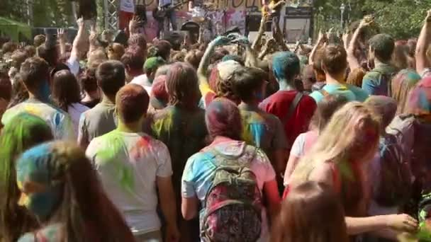 The festival of colors, people throw paints