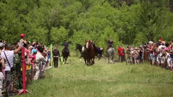 Girls don Cossacks riding on horses