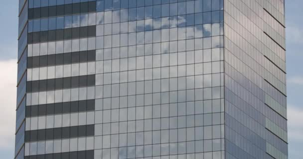 The clouds reflected in glass skyscraper