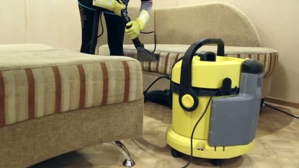 Service cleaning dirty sofa and chairs with special tool