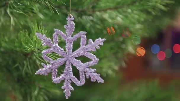Decorative snowflake hanging on a Christmas tree