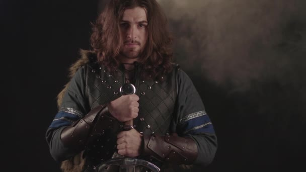 Medieval knight with ax in armor prepear to attack. Historical concept