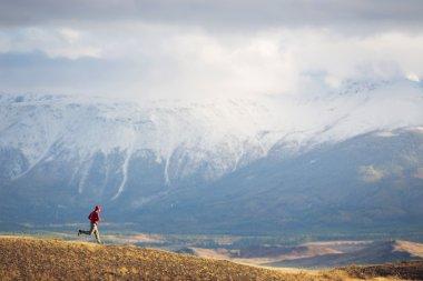 Runner rugged mountain terrain