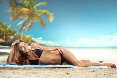 Girl lying on the beach
