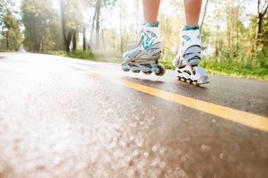 Legs of woman having roller skate exercise in outdoor