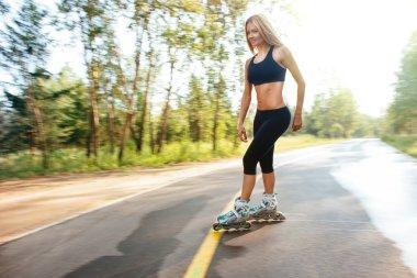Roller skating sporty girl in otdoor. Caucasian woman in outdoor fitness activities