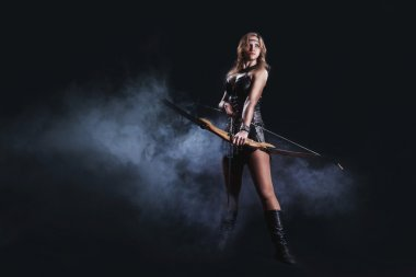 The fantasy hunter girl with bow and arrow