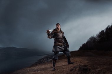 Medieval knight with sword in armor as style Game of Thrones in