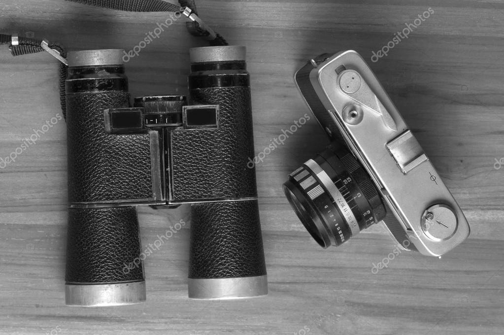 Jahrgang reise erinnerungen konzept alte kamera fernglas