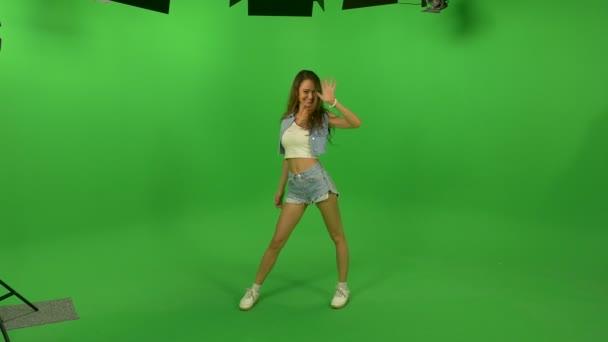 beautiful young girl waving at the camera