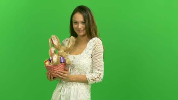 Sexy young girl holding a basket with Easter bunny
