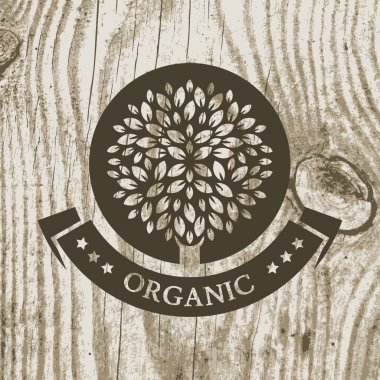 Organic product badge with tree on wooden texture. Vector illust