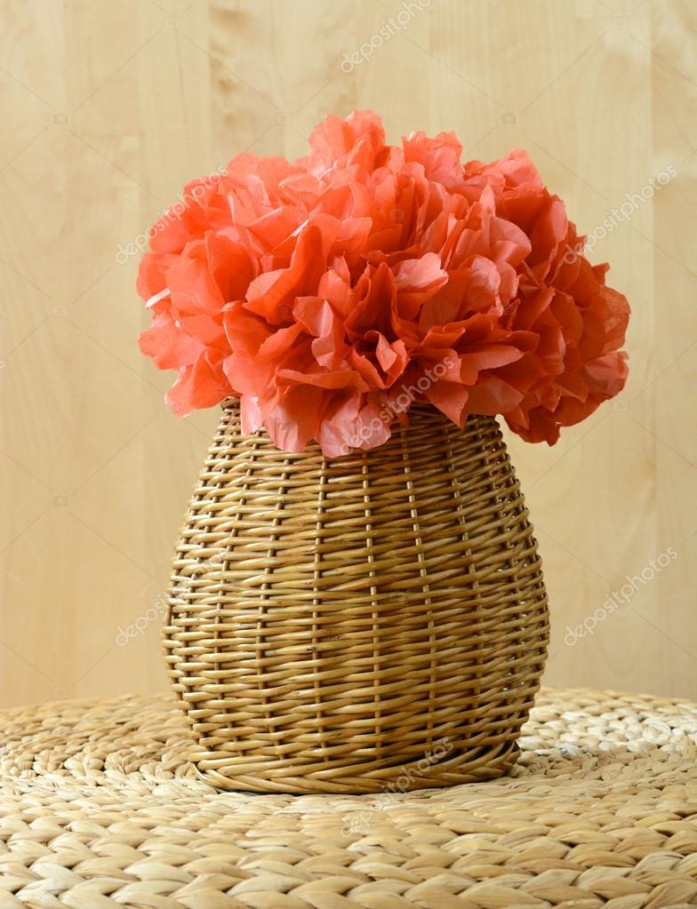 Vase Basket With Red Tissue Paper Flower On Woven Surface With Wood
