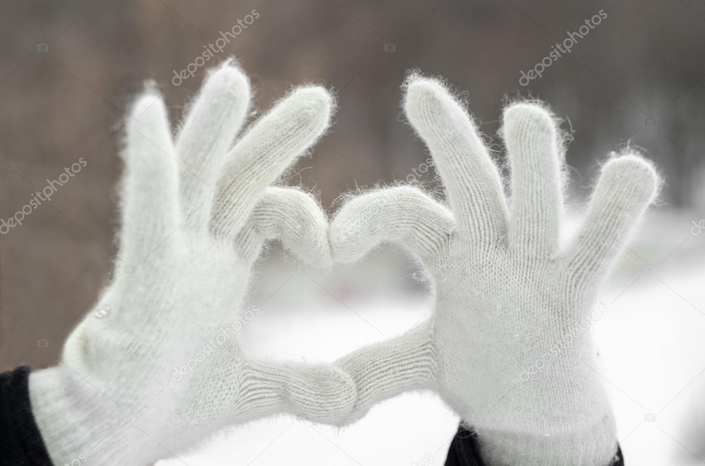 Hands holding a heart together