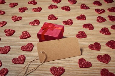 Valentines day small gift with red heart on wooden table stock vector