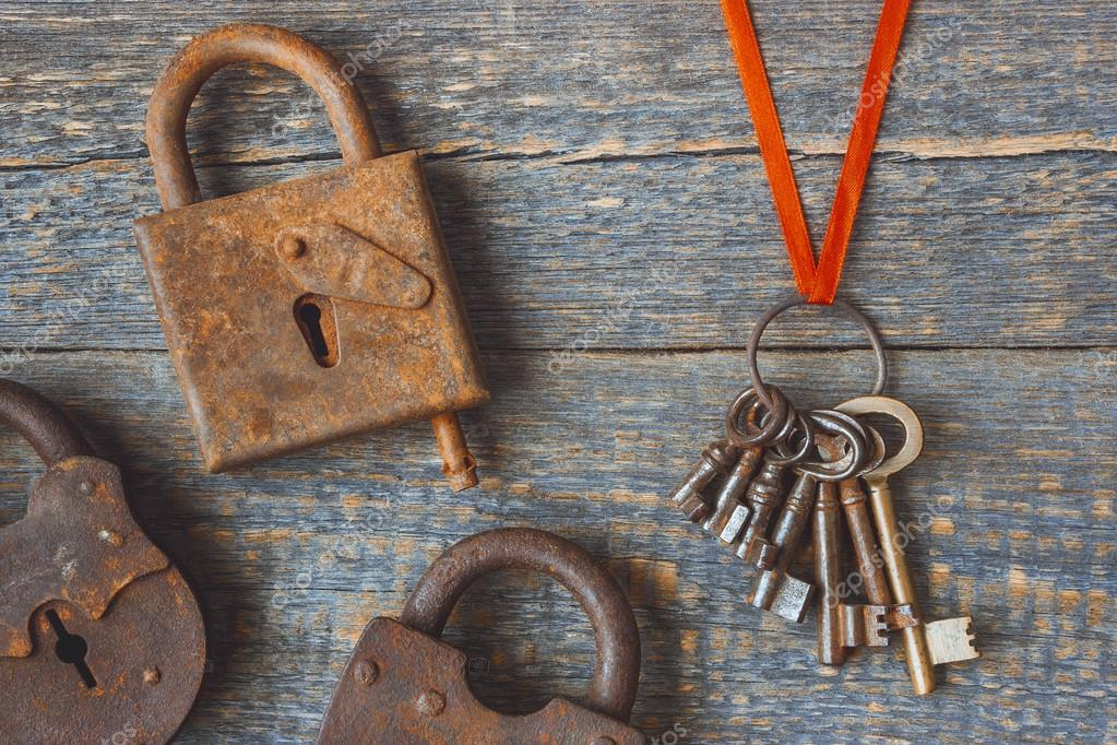 the old locks with a bunch of keys stock photo sergeka 110397016