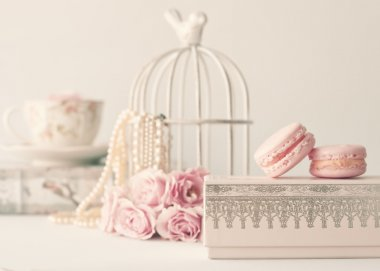Macaroons and roses with birdcage