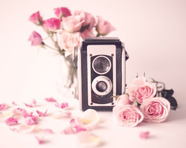 Retro camera with Peonies and roses
