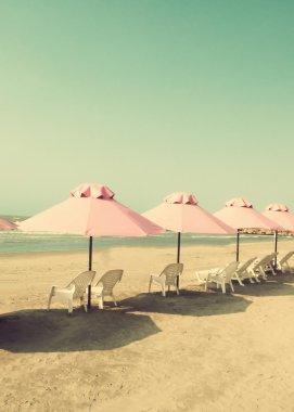 close up of umbrellas at beach