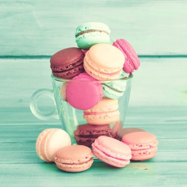 Colorful macaroons in a cup