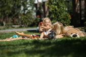 Mother with kids have fun on the grass