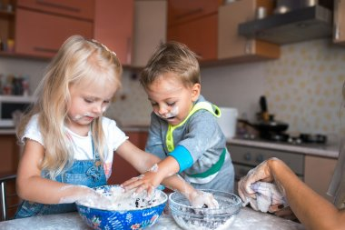 Children playing in the kitchen