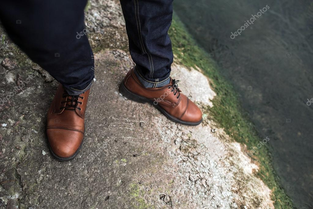 Feet of Men  in selvedge jeans and retro shoes
