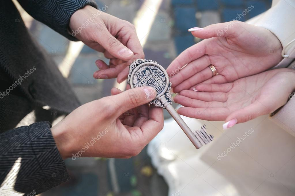 groom gives the bride a key