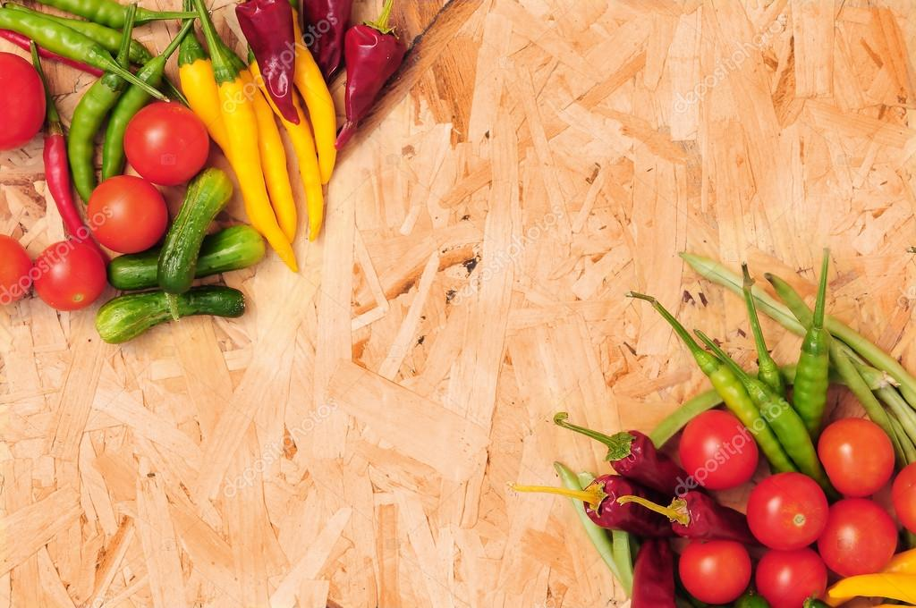 Colorful delicious vegetables on wood desk